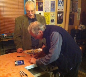 Geoff Muldaur autographs a CD for a fan